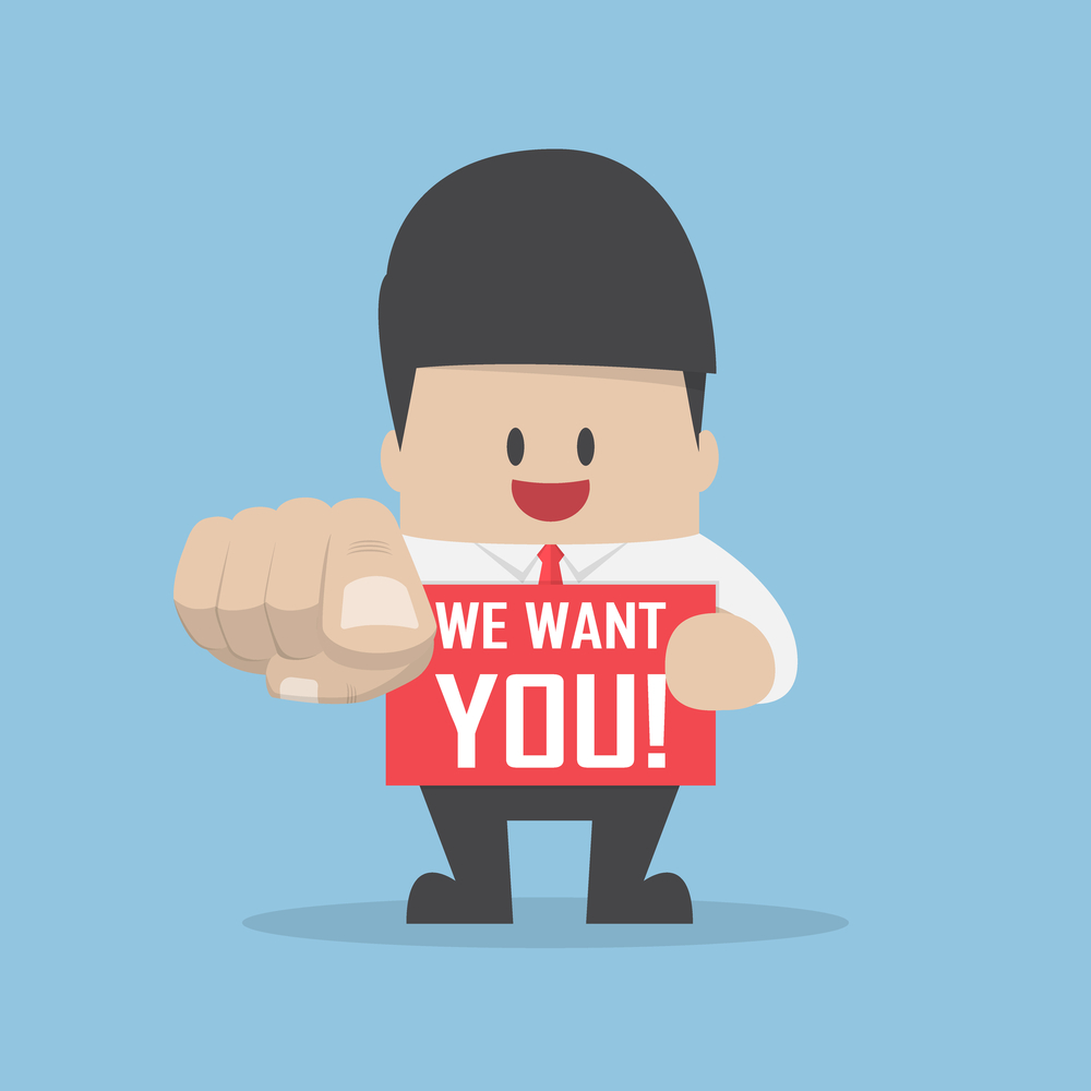 Businessman pointing finger towards you with word we want you, we're hiring and recruitment concept
