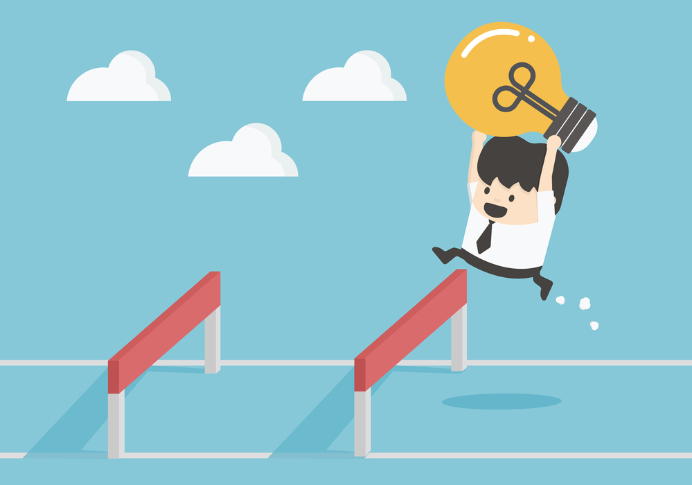 Businessman Jumping Over Hurdle